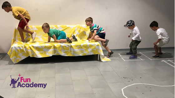 Children learning by completing an obstacle course at a future astronauts camp