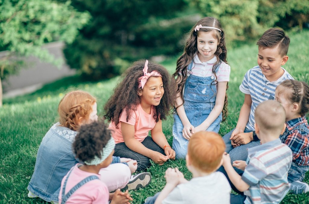 group of children talking to each other and developing communication skills